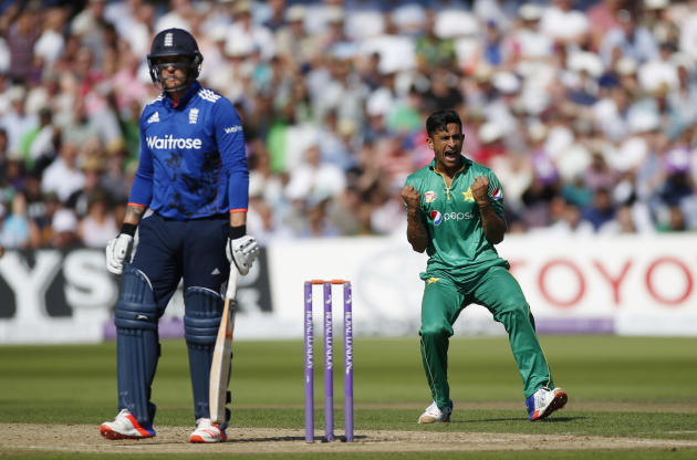 Pakistan's Hasan Ali celebrates the wicket of England's Jason Roy (L)