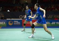Chinese badminton players take on South Korea during the women's doubles semi-finals at the All England Open Badminton Championships in March 2012. Badminton's world body has abandoned plans to force women players to wear skirts, officials said, in the face of fierce opposition which threatened to cause controversy during the Olympics