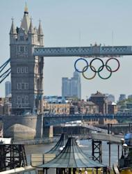 Olympics rings can be seen hanging from the tower bridge in London. In total, 18,200 soldiers are now helping to guard 10,500 competitors at the Games, alongside thousands of private guards and police