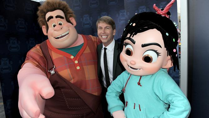 "FILE - In this Mon., Oct. 29, 2012 file photo, Jack McBrayer poses with characters Wreck-It Ralph, left, and Vanellope von Schweetz at the world premiere of ""Wreck-It Ralph"" at El Capitan Theatre, in Los Angeles.  McBrayer voices the character Fix-It Felix in the film that opened on Nov. 2. (Photo by Jordan Strauss/Invision/AP, File)"