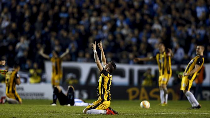 Players of Paraguay's Guarani react at the end of their Copa Libertadores quarter-final second leg soccer match against Argentina's Racing Club in Buenos Aires