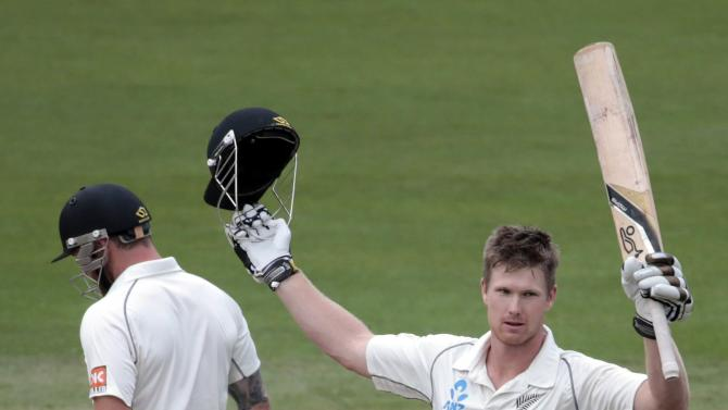 New Zealand's Neesham acknowledges his 100 against India during the second innings of play on day five of the second international test cricket match at the Basin Reserve in Wellington