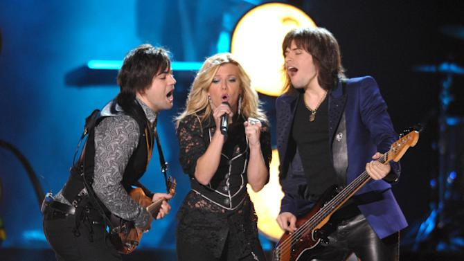FILE - In this Wed., June 6, 2012 file photo, from left, Neil Perry, Kimberly Perry and Reid Perry of The Band Perry perform at the 2012 CMT Music Awards, in Nashville, Tenn. The Band Perry continues to build an international fan base and met with fans from around the world during CMA Music Fest. (Photo by John Shearer/Invision/AP, File)