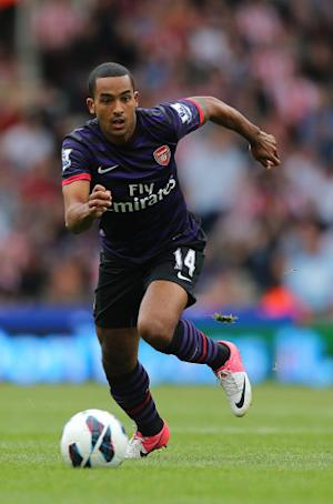 Theo Walcott denied the delay in signing a new Arsenal contract was over wages