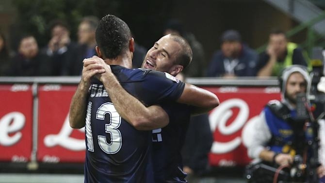 Inter Milan forward Rodrigo Palacio, right, of Argentina, celebrates with jhis teammate Colombian midfielder Fredy Guarin after scoring during the Serie A soccer match between Inter Milan and Hellas Verona at the San Siro stadium in Milan, Italy, Saturday, Oct. 26, 2013