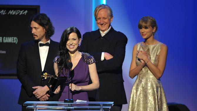 """From left, John Paul White, Joy Williams, T Bone Burnett and Taylor Swift accept the award for song written for visual media for """"Safe and Sound"""" (From The Hunger Games) at the 55th annual Grammy Awards on Sunday, Feb. 10, 2013, in Los Angeles. (Photo by John Shearer/Invision/AP)"""