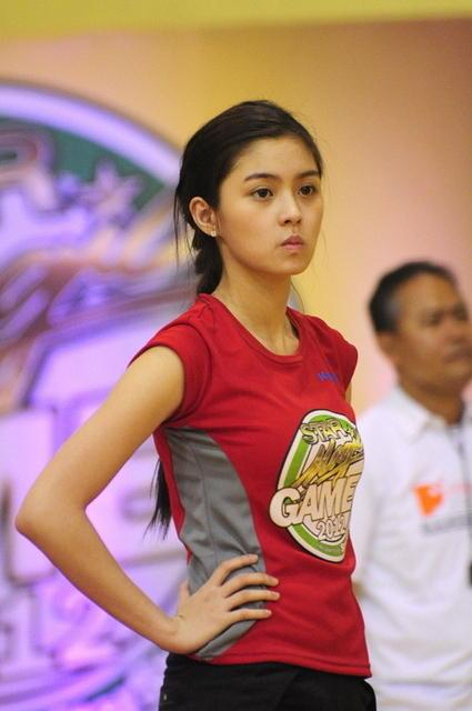 Kim Chiu waits for the volleyball game to start during the Star Magic Games held at the Celebrity Sports Club in Quezon City on 29 July 2012.