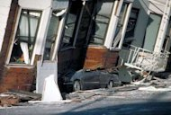 An automobile lies crushed under the third story of this apartment building in the Marina District, California, from the Loma Prieta earthquake in 1989.