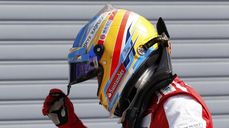 Ferrari Formula One driver Alonso is pictured after the qualifying session of the Italian F1 Grand Prix at the Monza circuit