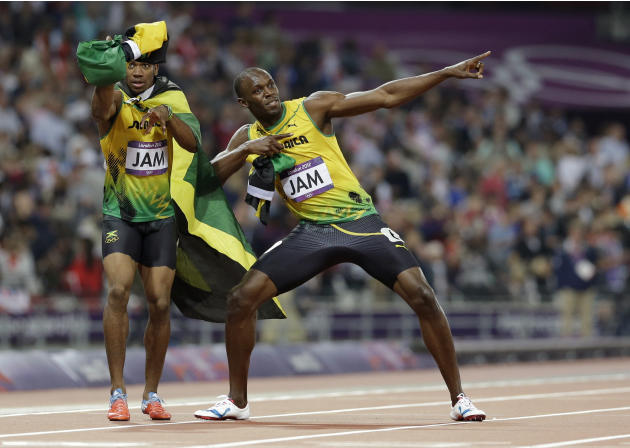Jamaica's Usain Bolt, right, and Yohan Blake celebrate their win in the men's 4 x 100-meter relay during the athletics in the Olympic Stadium at the 2012 Summer Olympics, London, Saturday, Aug. 11, 20