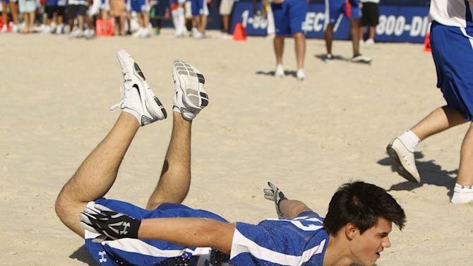 Taylor Lautner plays at the Fourth Annual DIRECTV Celebrity Beach Bowl at DIRECTV Celebrity Beach Bowl Stadium: South Beach on February 6, 2010 in Miami Beach, Florida.