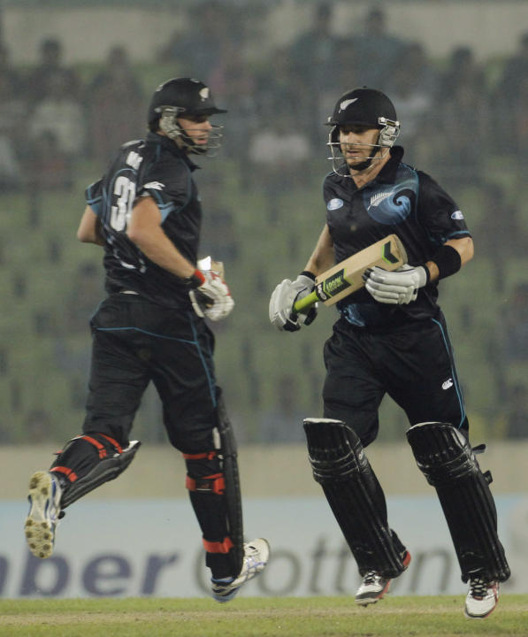New Zealand's Mills and McCullum run between the wickets against Bangladesh during their second one-day international cricket match in Dhaka