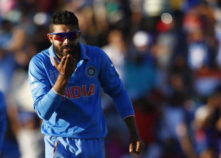 India's Jadeja blows a kiss to teammate Kohli, who captured West Indies' last wicket Holder, during his Cricket World Cup match in Perth