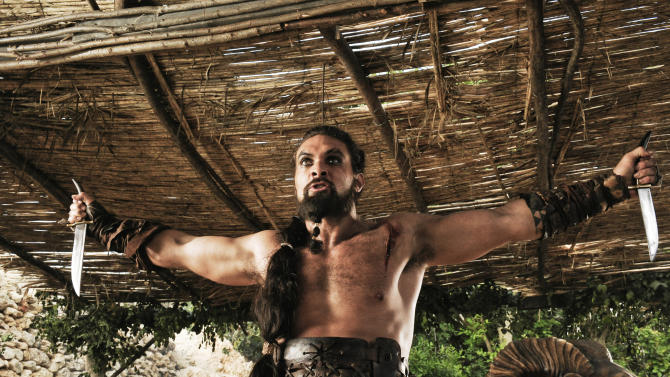 """In this publicity image released by HBO, Jason Momoa portrays Khal Drogo in a scene from the HBO series, """"Game of Thrones."""" The 63rd Emmy Award nomination announcements will be made on Thursday, July 14, 2011. (AP Photo/HBO, Helen Sloan)"""