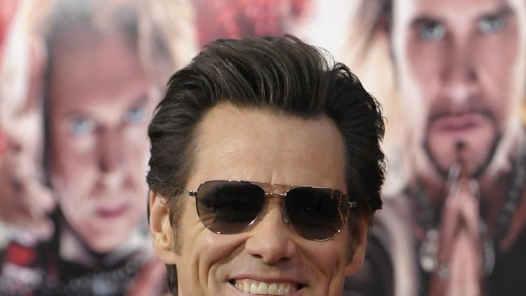 "Actor Jim Carrey arrives at the world premiere of the feature film ""The Incredible Burt Wonderstone"" at the TCL Chinese Theatre on Monday, March 11, 2013 in Los Angeles. (Photo by Dan Steinberg/Invision/AP)"