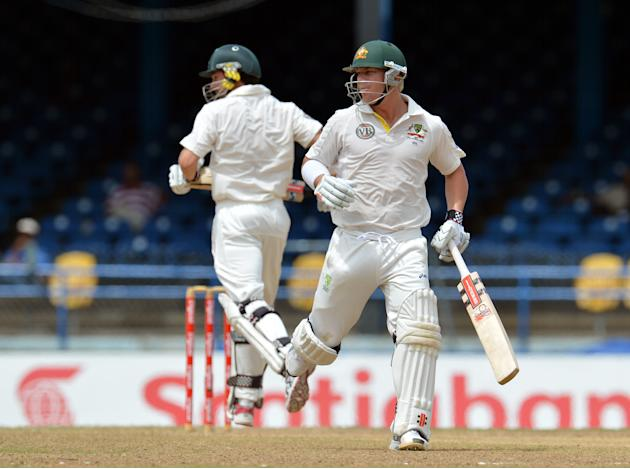Australian batsmen David Warner (R) and