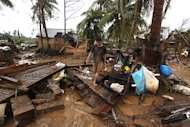 A resident walks amongst destroyed houses after Typhoon Bopha hit Compostela town, on the southern island of Mindanao on December 4. A moderate 5.6-magnitude earthquake shook the island of Mindanao Monday, seismologists said, but there were no immediate reports of damage or casualties