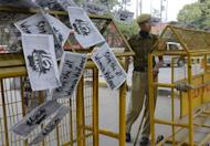 "An Indian police officer looks on near a string of anti-rape posters hung over a police barricade at Janatar Mantar in New Delhi on January 28, 2013. Verdicts for five men accused of the fatal gang-rape of a student on a New Delhi bus would be handed down ""very soon,"" a defence lawyer has said, as an application to relocate the trial failed"