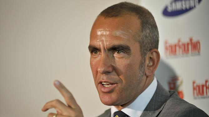 New Swindon Town soccer team manager Paolo Di Canio  speaks during the press conference at the County Ground, Swindon England Monday May 23, 2011. Swindon were relegated from the English Division One league (AP Photo/Ben Birchall, PA)  UNITED KINGDOM OUT