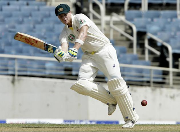 FILE - This is a Thursday, June 11, 2015, file photo of Australia's batsman Steven Smith as he plays a shot during the first day of the second cricket Test match against the West Indies in Kingsto