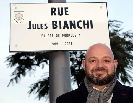 Philippe Bianchi, the father of Jules Bianchi Formula One driver who died on July 17, 2015 after an accident during the Japanese Grand Prix Formula 1 race, poses near the street plaque with his son&#3