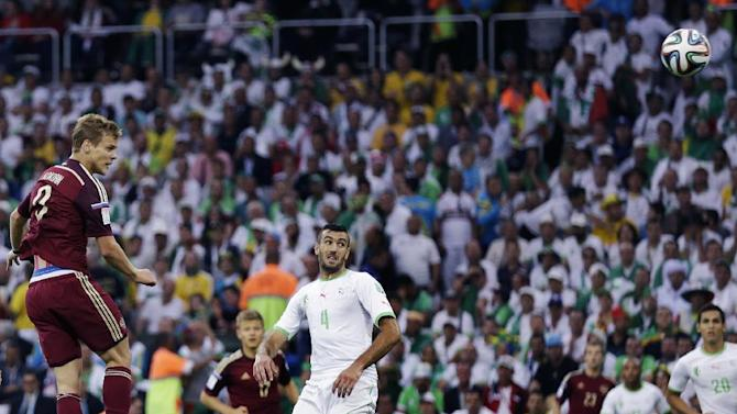 Algeria into 2nd round after 1-1 draw with Russia