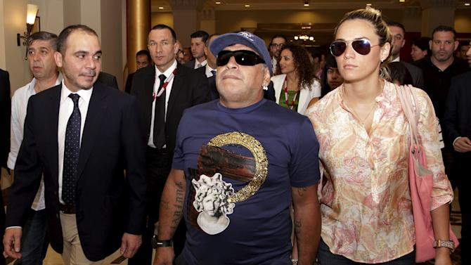 Jordan's Prince Ali Bin Al Hussein walks with Argentina's former soccer player Diego Maradona and his partner Rocio Oliva as they arrive for the opening of the Soccerex Asian Forum at the King Hussein Convention Center at the Dead Sea, Jordan