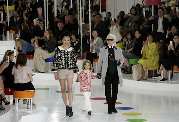 German fashion designer Karl Lagerfeld, right, walks the runway with models after the presentation of his 2015-2016 Chanel cruise collection at the Dongdaemun Design Plaza in Seoul, South Korea, Monda