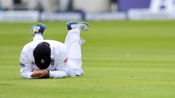 England cricketer Andrew Strauss reacts after missing a catch during the fourth day of the first Test against the West Indies at Lords cricket ground in London, England on May 20, 2012. AFP PHOTO/GLYN KIRK   RESTRICTED TO EDITORIAL USE. NO ASSOCIATION WITH DIRECT COMPETITOR OF SPONSOR, PARTNER, OR SUPPLIER OF THE ECBGLYN KIRK/AFP/GettyImages