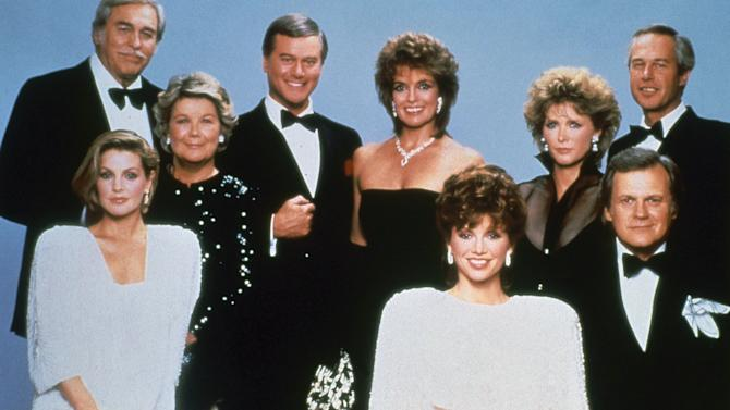 "FILE - This 1983 file photo shows actor Larry Hagman, center left, with fellow cast members of the television series ""Dallas."" Back row from left are Howard Keel, Barbara Bel Geddes, Larry Hagman, Linda Grey, Susan Howard and Steve Kanaly. Front row from left are Priscilla Presley, Victoria Principal and Ken Kercheval.  Actor Larry Hagman, who for more than a decade played villainous patriarch JR Ewing in the TV soap Dallas, has died at the age of 81, his family said Saturday Nov. 24, 2012.  (AP Photo/CBS, File)"