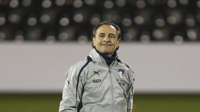Italy's coach Cesare Prandelli watches his players during a training session at Craven Cottage in London, Sunday, Nov. 17, 2013. Italy is to play a friendly soccer match against Nigeria on Monday Nov. 18 at Craven Cottage in London