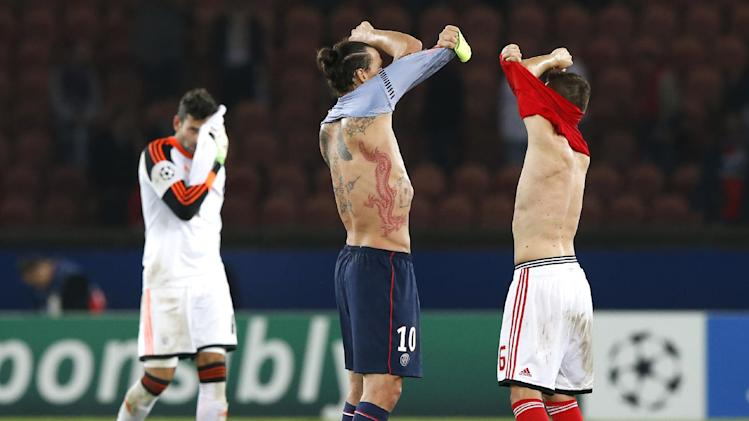 PSG's Zlatan Ibrahimovic, center, and Benfica's Guilherme Siqueira, right, put off their shirts after their Champions League group C soccer match between Paris Saint Germain and Benfica at Parc des Princes stadium, in Paris, Wednesday, Oct.2, 2013. PSG won 3-0. At left behind is Benfica's goalkeeper Artur Moraes