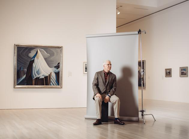 """In this Wednesday, Oct. 7, 2015 photo, curator and actor-comedian Steve Martin poses for a portrait in a gallery for the exhibit """"The Idea of North: The Paintings of Lawren Harris"""" at The Ha"""