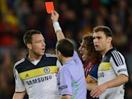 Chelsea's defender John Terry (2nd left) receives a red card from Turkish referee Cuneyt Cakir during the UEFA Champions League semi-final match against Barcelona at the Cam Nou stadium in Barcelona. Roberto Di Matteo hailed the phenomenal spirit of his players after Chelsea completed the latest in a line of stunning fightbacks to upset Barcelona and advance to the Champions League final