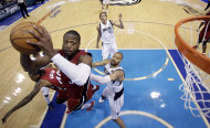 Miami Heat's Dwyane Wade goes up for a shot during the second half of Game 3 of the NBA Finals basketball game against the Dallas Mavericks Sunday, June 5, 2011, in Dallas. The Heat won 88-86 take a 2-1 lead in the series. (AP Photo/David J. Phillip; Pool)