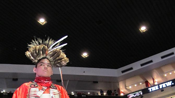 An unidentified dancer awaits his turn during the Gathering of Nations in Albuquerque, N.M., on Friday, April 26, 2013. The powwow draws hundreds of competitive Native American and indigenous dancers as well as tens of thousands of spectators each year. (AP Photo/Susan Montoya Bryan)