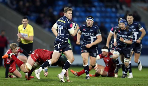Will Addison of Sale Sharks in action with Jake Ball of Scarlets