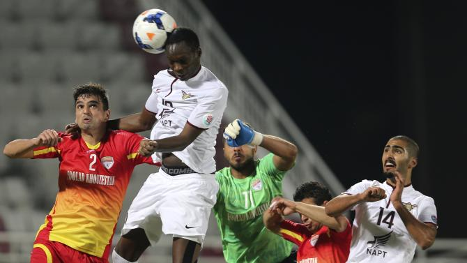 Abkar of El Jaish's fights for the ball with Padovani of Foolad during their AFC Champions League soccer match in Doha