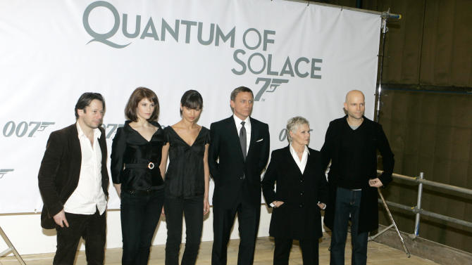 "FILE - This Jan. 24, 2008 file photo shows actors, from left, Mathieu Amalric, Gemma Arterton, Olga Kurylenko, Daniel Craig, Judy Dench, and director Marc Forster posing at a photo call for the Bond film, ""Quantum of Solace,"" at Pinewood Studios in Buckinghamshire, England. Georgia's film industry is booming and big plans are in the works for major studio projects. Of those studio projects in the works, one being planned in Fayette County, a short drive south of Atlanta, could be a game changer. British film studio Pinewood Shepperton PLC, home to the James Bond franchise, has reportedly been in talks with a group of investors to manage and operate the facility. It would be Pinewood's first production facility in the U.S. (AP Photo/Kirsty Wigglesworth, File)"