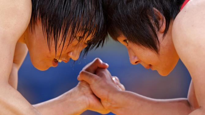 China's Ruixue Jing fights with North Korea's Un Gyong Choe on the Women's 63Kg Greco-Roman wrestling at the ExCel venue during the London 2012 Olympic Games