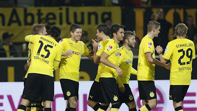 Dortmund's Robert Lewandowski of Poland , third from  left, celebrates with teammates after scoring during the German first division Bundesliga soccer match between  BvB Borussia Dortmund and VfB Stuttgart  in Dortmund, Germany, Friday, Nov. 1, 2013