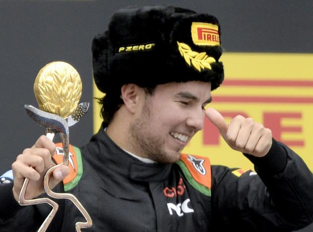 Sahara Force India F1 Team's Mexican driver Sergio Perez celebrates his third place after the Russian Formula One Grand Prix at the Sochi Autodrom circuit on October 11, 2015