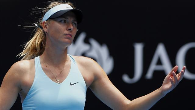 Australian Open - Cibulkova shocks Sharapova, Halep overcomes Jankovic