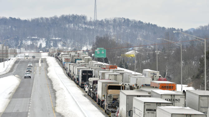 Traffic backs up as more than 50 miles of Interstate 65 southbound is shut down from the weather, Thursday, March 5, 2015, near Mount Washington, Ky. Kentucky State Police reported that the interstate will not reopen until Thursday evening. Kentucky has been walloped by a winter storm that has dumped nearly 2 feet of snow in parts of the state. (AP Photo/Timothy D. Easley)