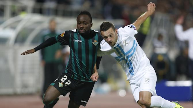 Betis' Cedric, left, is challenged by Rijeka's Ivan Tomecak during their group I Europa League first round second leg soccer match, at Kantrida stadium in Rijeka, Croatia, Thursday, Oct. 3, 2013