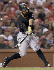 FILE - In this July 6, 2016, file photo, Pittsburgh Pirates' Sean Rodriguez hits an RBI-single during the sixth inning of a baseball game against the St. Louis Cardinals in St. Louis. Atlanta Braves general manager John Coppolella said Monday, Feb. 13, 2017, he is not sure whether it is realistic to hope for a return this season of Rodriguez who will have shoulder surgery. Rodriguez agreed to an $11.5 million, two-year contract with Atlanta in November. (AP Photo/Jeff Roberson, File)