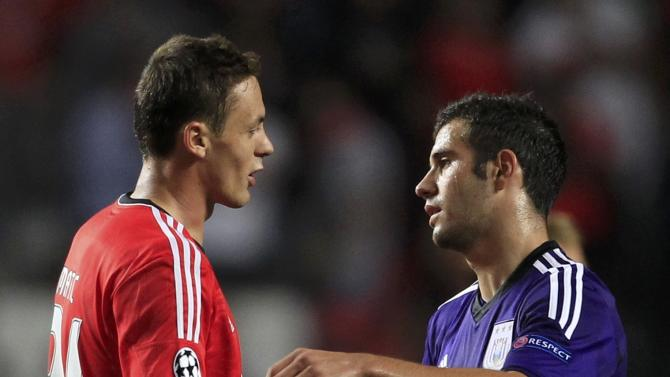 Benfica's Serbian player Matic is congratulated by Anderlecht's Serbian player Milivojevic after the final whistle of their Champions League soccer match at the Luz Stadium in Lisbon