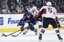 Ottawa Senators' Alex Chiasson (90) trips Winnipeg Jets' Anthony Peluso (14) as Sens' Cody Ceci (5) defends during second period NHL action in Winnipeg on Wednesday, March 4, 2015. THE CANADIAN PRESS/John Woods