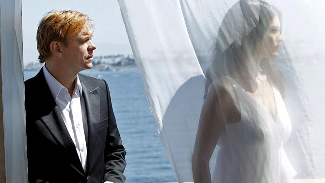 """Countermeasures"" -- Horatio's (David Caruso, left) and Natalia's lives hang in the balance, as Horatio stands between Natalia and certain death. Alana De La Garza (right) returns as Horatio's late wife, Marisol Caine. Meanwhile, it's a race against time for the team to capture escaped killer Jack Toller before he kills again, on the 10th season premiere of CSI: MIAMI, Sunday, Sept. 25 (10:00-11:00 PM, ET/PT) on the CBS Television Network. Photo: Cliff Lipson/CBS ©2011 CBS Broadcasting, Inc. All Rights Reserved. CSI: Miami"