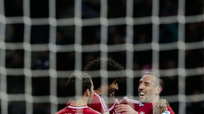 Bayern's Franck Ribery of France celebrates with Dante of Brazil and Mario Goetze, from right, after he scores his side's third goal during the first division Bundesliga soccer match between Hertha BSC and FC Bayern Munich in Berlin, Tuesday, March 25, 2014